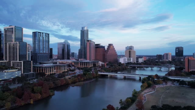the aerial drove view of austin downtown, texas, usa, from auditorium shores at town lake park across colorado river. aerial drone video with the panoramic-rotation camera motion. - texas stock videos & royalty-free footage