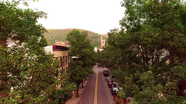 the aerial panoramic scenic view of the small mountain city jim thorpe (mauch chunk)  in poconos, pennsylvania. drone footage with the forward camera motion. - town stock videos & royalty-free footage