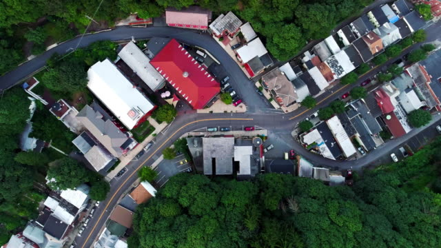 the aerial panoramic scenic view of the small mountain city jim thorpe (mauch chunk)  in poconos, pennsylvania. the directly-above drone footage with the ascending-spinning camera motion - pennsylvania stock videos & royalty-free footage