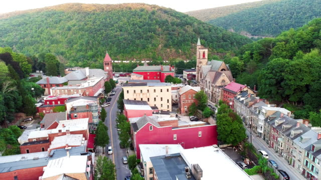the aerial panoramic scenic view of the small mountain city jim thorpe (mauch chunk)  in poconos, pennsylvania. the drone footage with the backward-descending camera motion. - appalachian mountains stock videos & royalty-free footage