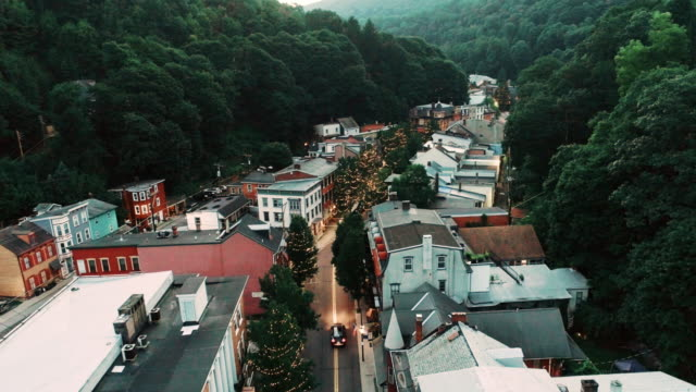 the aerial panoramic scenic view of the small mountain city jim thorpe (mauch chunk)  in poconos, pennsylvania. drone footage with the slow forward camera motion. - railway station stock videos & royalty-free footage