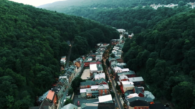the aerial panoramic scenic view of the small mountain city jim thorpe (mauch chunk)  in poconos, pennsylvania. drone footage with the forward camera motion. - railway station stock videos & royalty-free footage