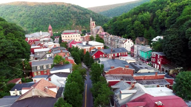 The aerial panoramic scenic view of the small mountain city Jim Thorpe (Mauch Chunk)  in Poconos, Pennsylvania. The drone footage with the backward camera motion.