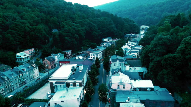 the aerial panoramic scenic view of the small mountain city jim thorpe (mauch chunk)  in poconos, pennsylvania. the drone footage with the accelerated forward camera motion - hill stock videos & royalty-free footage