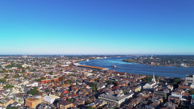 the aerial panoramic view of new orleans at evening. the mississippi river and the historic french quarter.  aerial drone video with the static camera. - river mississippi stock videos & royalty-free footage