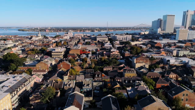 the aerial panoramic view of new orleans at evening. the mississippi river, historic french quarter and downtown. aerial drone video with the slow forward and panoramic camera motion. - river mississippi stock videos & royalty-free footage