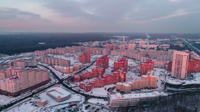The aerial panoramic view on the residential district with multistorey apartment buildings in the big city. Descending camera motion