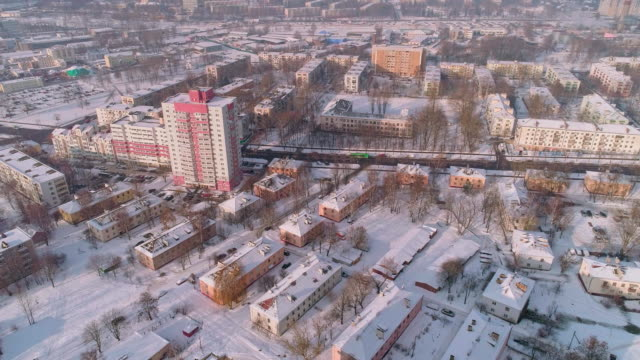 the aerial panoramic view on the winter city covered by the snow in the bright cold sunny day - sunny stock videos & royalty-free footage