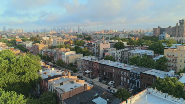 the aerial scenic remote view from brooklyn, over the residential district, toward manhattan. panoramic camera motion. - brooklyn new york stock videos & royalty-free footage