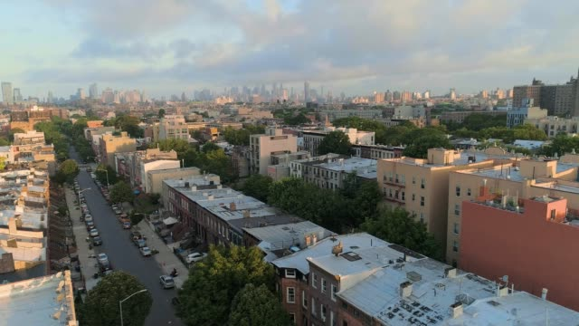 the aerial scenic remote view from brooklyn, over the residential district, toward manhattan. panoramic camera motion. - district stock videos & royalty-free footage