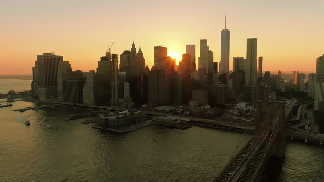 the aerial scenic view to manhattan downtown and brooklyn bridge from brooklyn heights over the east river at the sunset.wide panoramic orbit motion. - east river stock videos & royalty-free footage