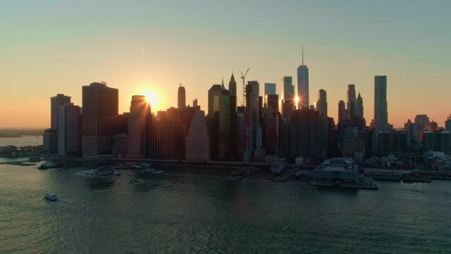 the aerial scenic view to manhattan downtown from brooklyn heights over the east river at the sunset. right-directed panoramic camera motion. - brooklyn new york stock videos & royalty-free footage