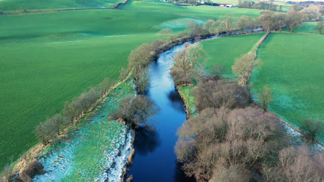 the aerial view from a drone of a small river in rural south west scotland - tilt down stock videos & royalty-free footage