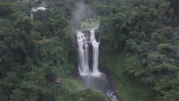The aerial view of Bolaven Plateau, Tad Yuang or Yuang fall, The big waterfall in green jungle near Pakse,Champasak,Laos. It is high resolution 4k from drone eye view. It include pan and tilt shot.