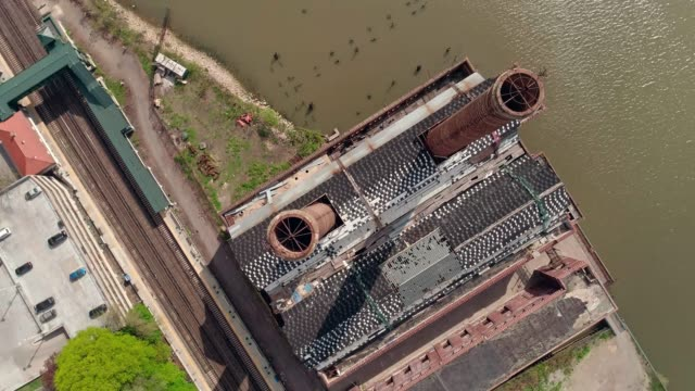 The aerial view of the abandoned factory of New York Central Railroad - Power Plant at the Hudson River in Yonkers.