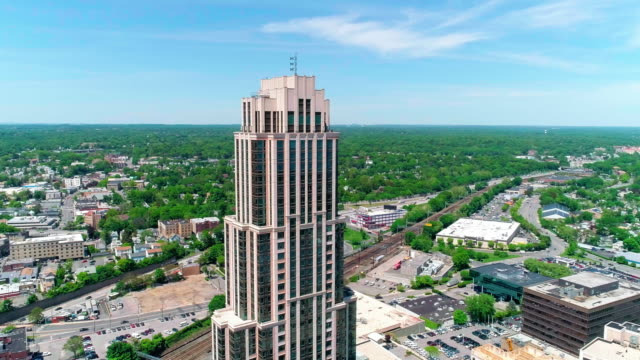 the aerial view of the skyscrapers in the downtown of new rochelle, westchester county, new york state - new york stato video stock e b–roll