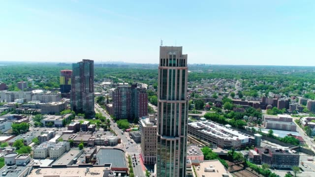 the aerial view of the skyscrapers in the downtown of new rochelle, westchester county, new york state - stati del mid atlantic usa video stock e b–roll