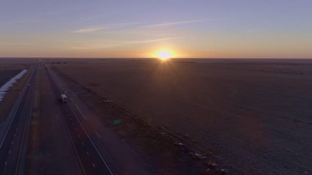 the aerial view of the sunrise over the highway in kansas - midwest usa stock videos & royalty-free footage