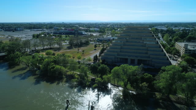 the aerial view of the ziggurat building in sacramento, california. drone video with the wide panoramic camera motion. - ziggurat stock videos and b-roll footage