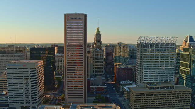 the aerial view on downtown baltimore, maryland, usa, at sunset. drone video with the panning camera motion. - baltimore maryland stock videos & royalty-free footage