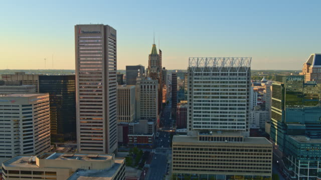 the aerial view on downtown baltimore, maryland, usa, at sunset. drone video with the forward camera motion. - baltimore maryland stock videos & royalty-free footage