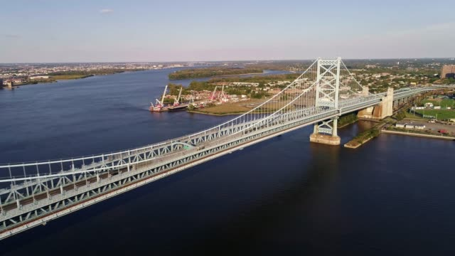 The aerial view over the Benjamin Franklin Bridge across the Delaware River from Philadelphia, PA to Cadmen, NJ