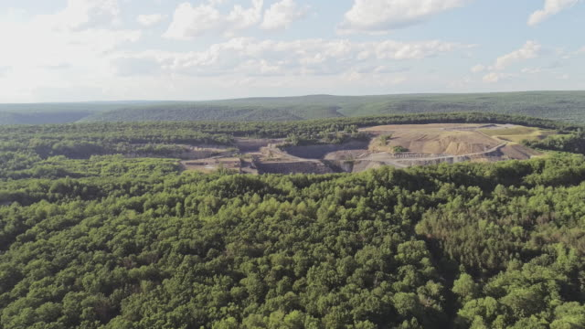 the aerial view to the open-cast mine in lehigh valley, carbon county, pennsylvania, usa. - quarry stock videos and b-roll footage