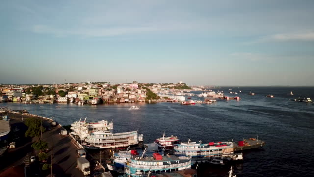 the aerials of manaus are from the waterfront near the municipal market on the rio negro just before it meets with the amazon river also from manaus... - river amazon stock videos & royalty-free footage