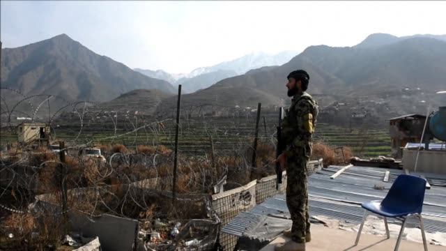 the afghan national army were on high alert monday near kunar province which borders pakistan following the taliban's deadly attack on a border... - afghan national army stock videos and b-roll footage