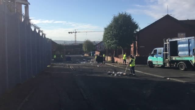 the aftermath of last night's disorder in belfast where police were attacked and cars torched by masked youths they were apparently angered by the... - credit union stock videos & royalty-free footage