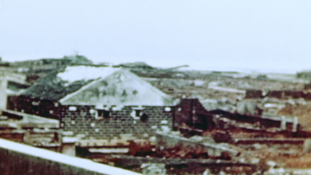 PAN The aftermath of the Marine Corps assault including destroyed buildings and rubble / Naha Okinawa Japan