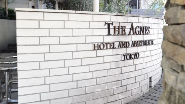 The Agnes Hotel and Apartments stands in Tokyo Japan on Tuesday Jan 31 Signage for The Agnes hotel and Apartments is displayed at the building...