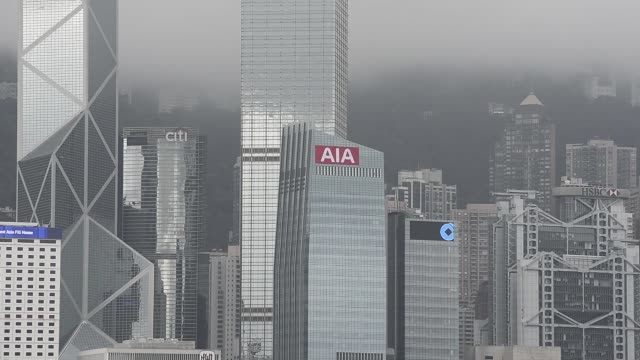 the aia central building, home to the headquarters of aia group ltd., center, stands among other skyscrapers in the business district of central in... - bank of china tower hong kong stock videos & royalty-free footage