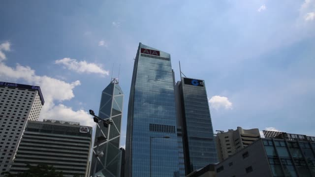 the aia central building which houses the headquarters of aia group ltd center stands near the bank of america tower from left hutchison house bank... - bank of china tower hong kong stock videos & royalty-free footage
