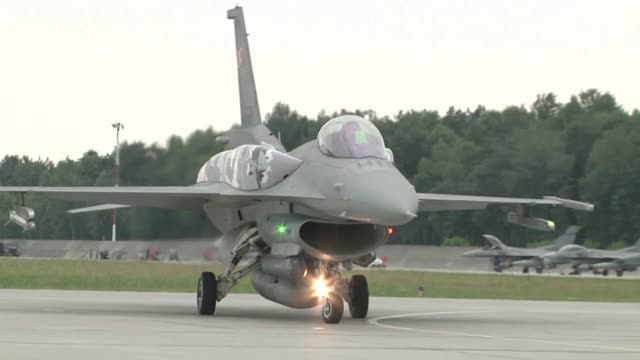 the air force along with its polish counterparts officially kicked off nato exercise ramstein guard with the first f16 flights from the south... - militärövning bildbanksvideor och videomaterial från bakom kulisserna