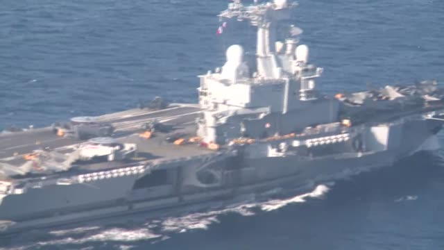the aircraft carrier charles de gaulle is sent to the eastern mediterranean to triple frances air capacity in syria and irak - irak stock videos and b-roll footage