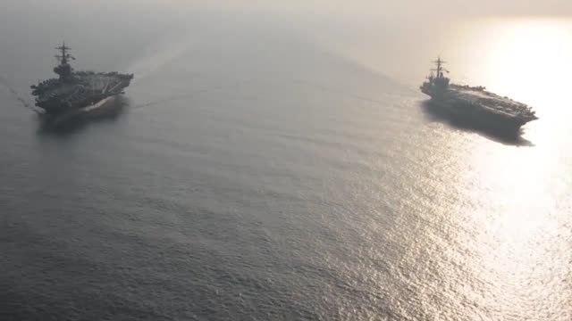 stockvideo's en b-roll-footage met the aircraft carrier uss carl vinson relieves uss george hw bush in the arabian gulf george hw bush will soon depart the us 5th fleet area of... - 70 79 jaar