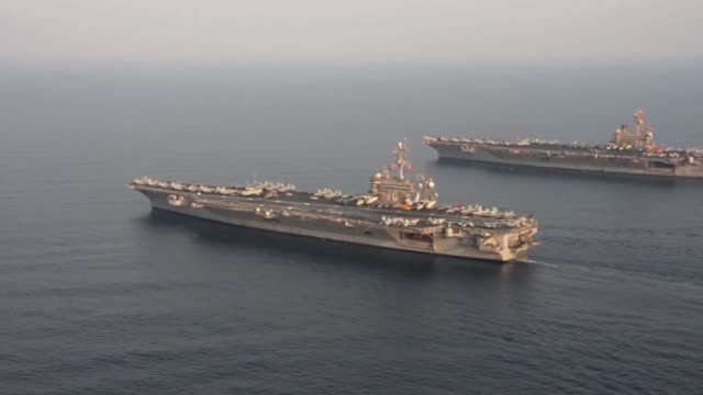 The aircraft carrier USS Carl Vinson relieves USS George HW Bush in the Arabian Gulf George HW Bush will soon depart the US 5th Fleet area of...