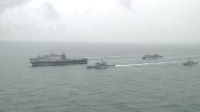 stockvideo's en b-roll-footage met the aircraft carrier uss enterprise leads the formation at the enterprise carrier strike group comprised of guided missile cruise uss vicksburg and... - amerikaanse zeemacht