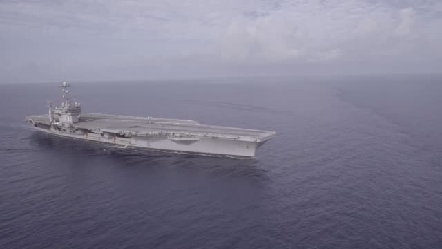 the aircraft carrier uss george washington operates in the atlantic ocean george washington homeported in norfolk is underway conducting carrier... - 海軍点の映像素材/bロール