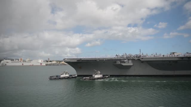 the aircraft carrier uss ronald reagan transits to joint base pearl harbor-hickam to participate in the rim of the pacific 2014 exercise. twenty-two... - pacific war stock-videos und b-roll-filmmaterial