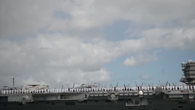 the aircraft carrier uss ronald reagan transits to joint base pearl harbor-hickam to participate in the rim of the pacific 2014 exercise. twenty-two... - uniform stock videos & royalty-free footage