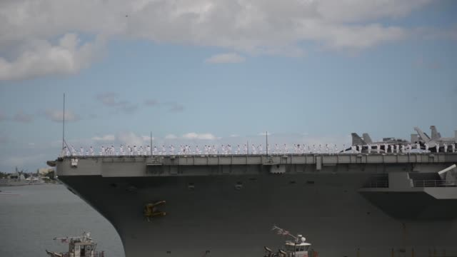 the aircraft carrier uss ronald reagan transits to joint base pearl harborhickam to participate in the rim of the pacific 2014 exercise twentytwo... - 海軍点の映像素材/bロール