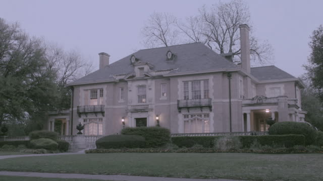 LA The Aldredge House at dusk with interior and exterior lights on / Dallas, Texas, United States
