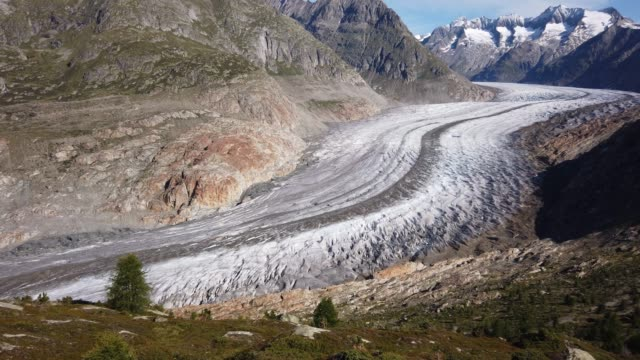the aletsch glacier winds down through a basin it once covered with ice at least 100 meters deeper than today on august 22 2019 near bettmeralp... - european alps stock videos & royalty-free footage