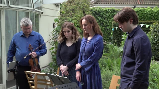 the alexander street quartet stand for a minute's silence at 11am on the 75th anniversary of of ve day prior to their midday concert at st john's... - midday stock videos & royalty-free footage
