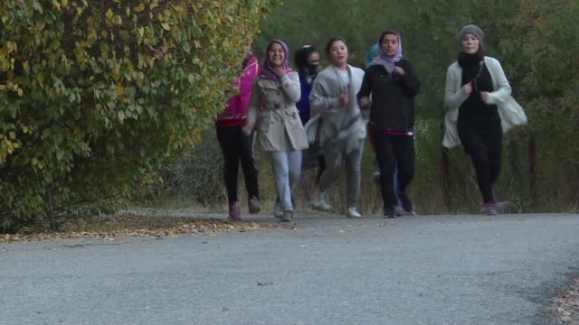 the all female free to run group hits kabul city's trails and parks several times a week braving disapproving looks verbal abuse and even physical... - kabul stock videos & royalty-free footage