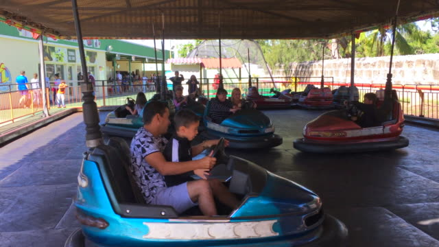 stockvideo's en b-roll-footage met the 'all in one' is an amusement park with a little shopping mall in the downtown district of the tourist city. everything there is priced in cucs .... - botsauto