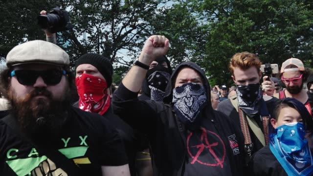 the altright attempted to hold a 'free speech' rally in downtown boston but the small group of altright demonstrators were overwhelmed by thousands... - anti fascism stock videos & royalty-free footage