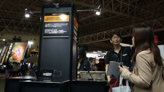 stockvideo's en b-roll-footage met the amazon.com inc. booth stands at the tokyo game show 2015 at makuhari messe in chiba, japan, on friday, sept. 18, 2015. shots: the twitch... - television game show